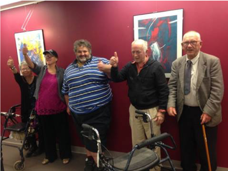 Some of the members from the Our Voice committee doing thumbs up