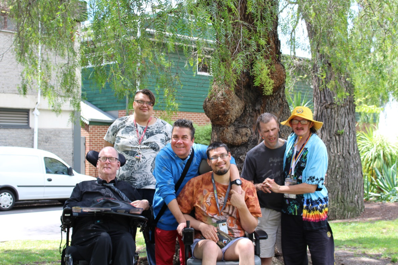 Picture of the Rainbow Rights Self Advocacy Group committee standing in park
