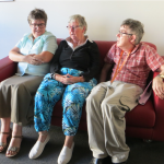 picture of Self Advocacy Western Australia committee members sitting on a couch together