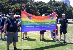 Committee holding a sign at a LGBTIQ Rights event