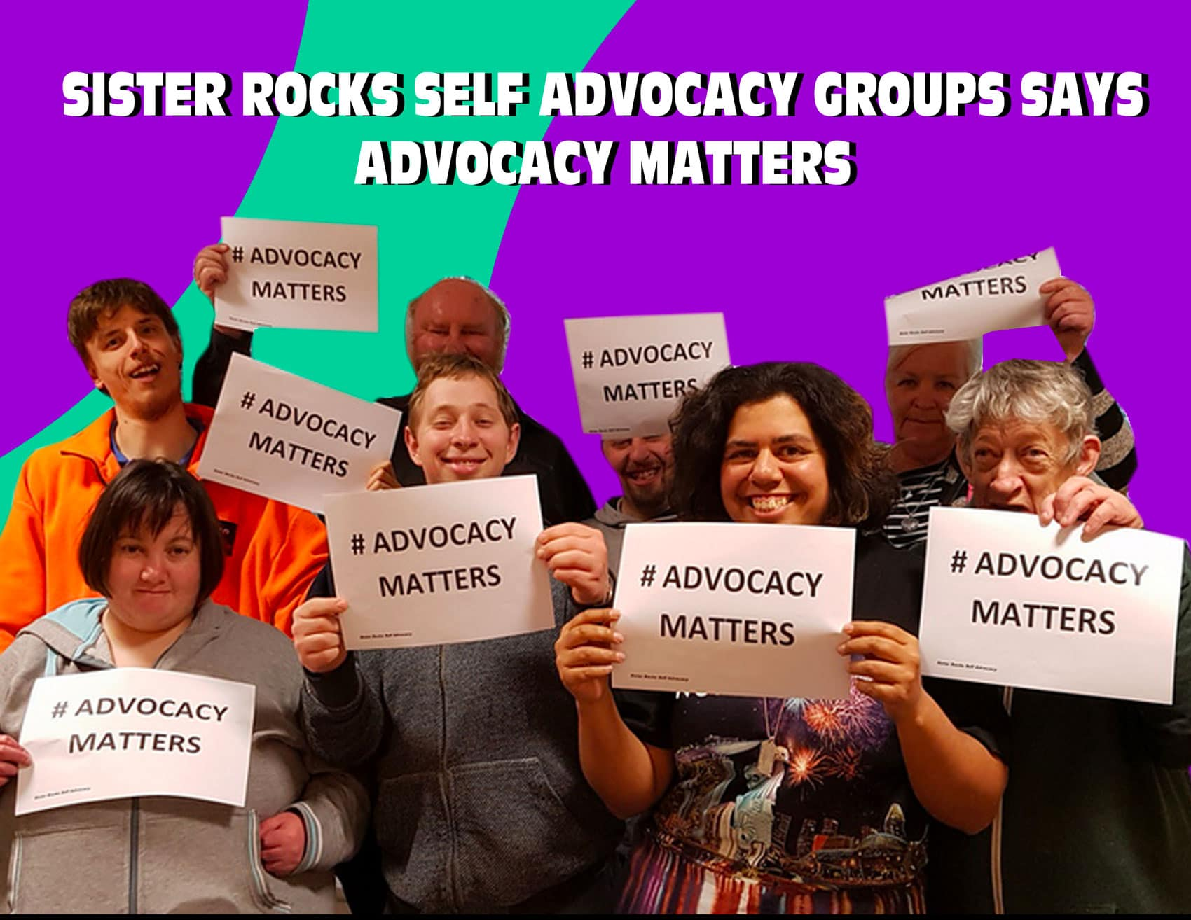 Picture of Sister Rocks Self Advocacy committee holding signs