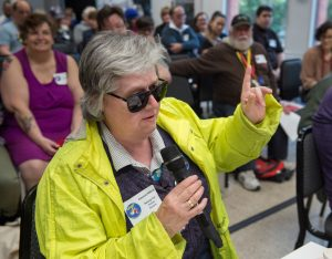 committee member holding microphone during meeting