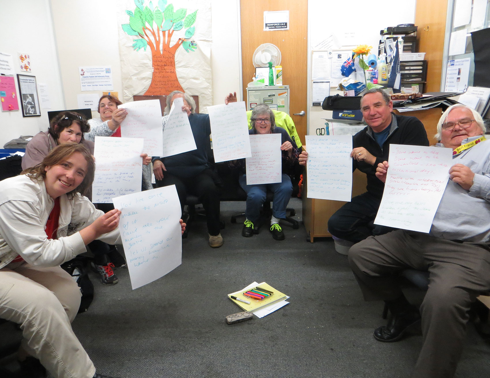 image of Intellectual Disability Community holding paper